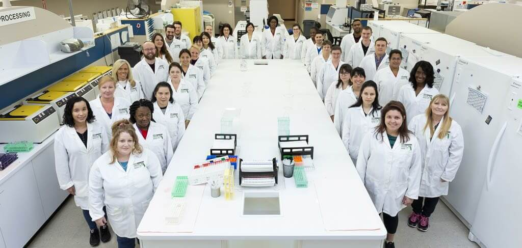 staff photo inside acs cannabis laboratory